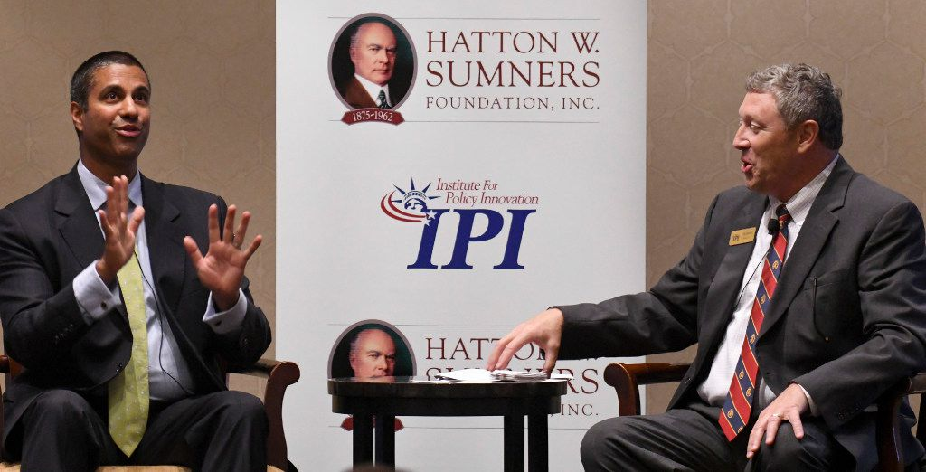 Ajit Pai, left, FCC Chairman, answers a question from Tom Giovanetti, president of the Institute for Policy Innovation during a Q & A at the Omni Mandalay Hotel in the Las Colinas area of Irving, Texas on September 7, 2017. (Robert W. Hart/Special Contributor)