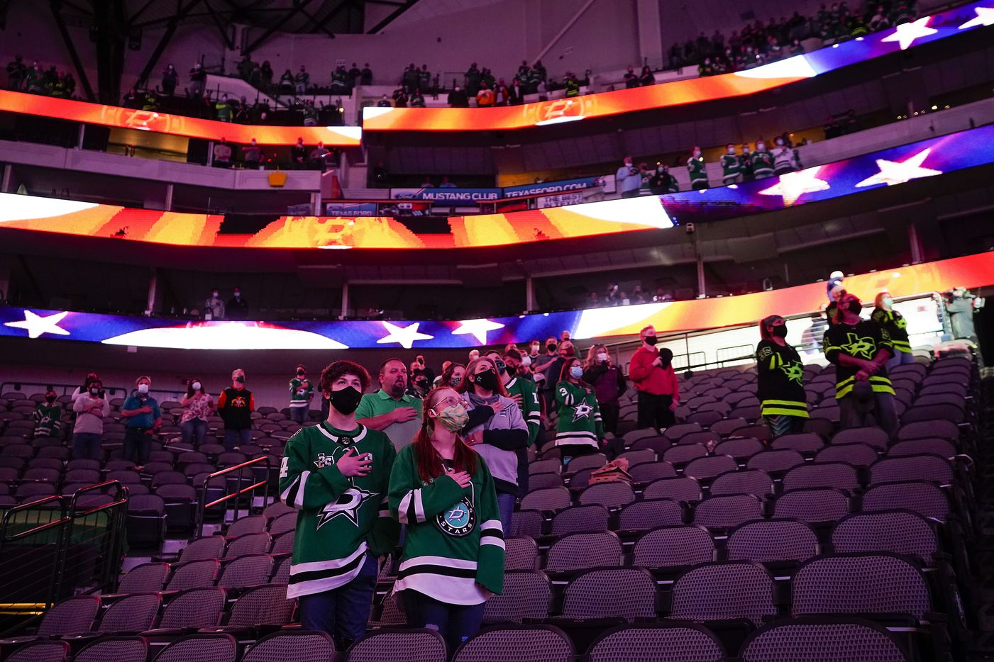 Dallas Stars fans stand for the national anthem before an NHL hockey game against the Tampa Bay Lightning at the American Airlines Center on Thursday, March 25, 2021, in Dallas. (Smiley N. Pool/The Dallas Morning News)