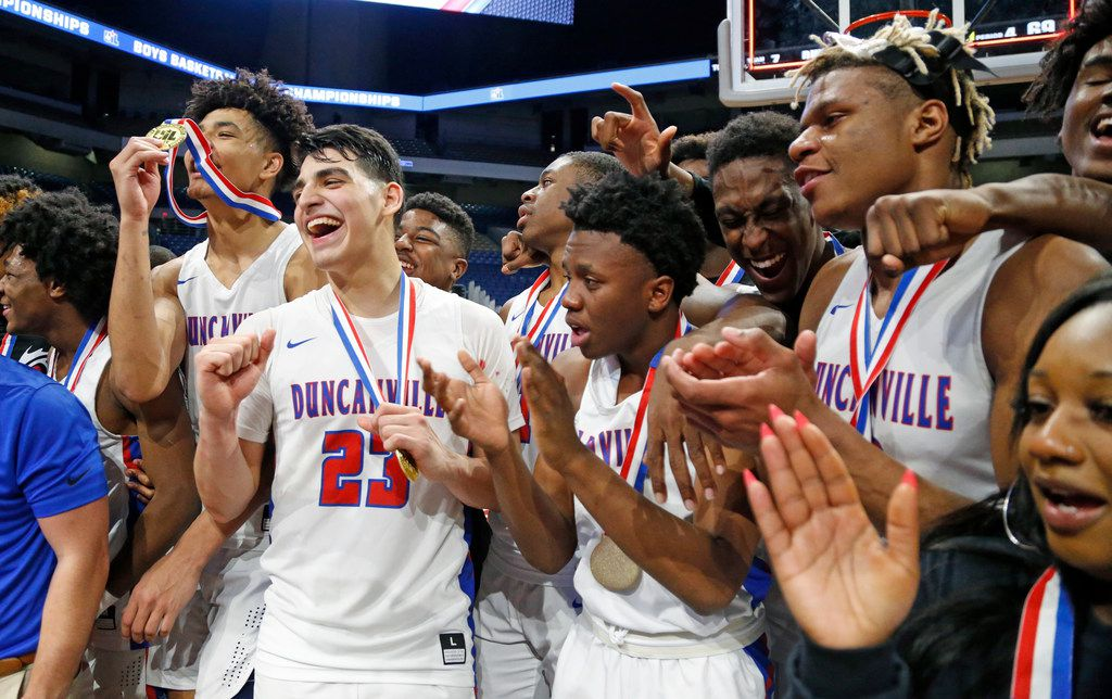 Duncanville players celebrate their 73-69 win against Klein Forest in the Class 6A state championship game last season at the Alamodome in San Antonio, Texas. (Ron Cortes/ Special Contributor)