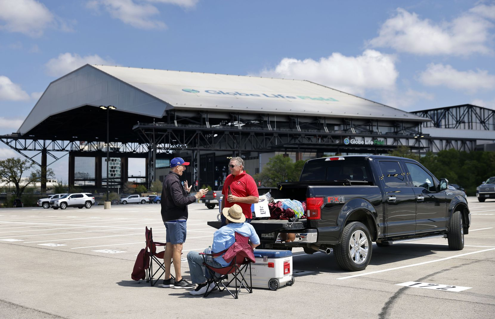 Texas Rangers fans enjoy an Opening Day tailgate party outside of Globe Life Field in Arlington, Monday, April 5, 2021. The Rangers are facing the Toronto Blue Jays in the home opener. (Tom Fox/The Dallas Morning News)