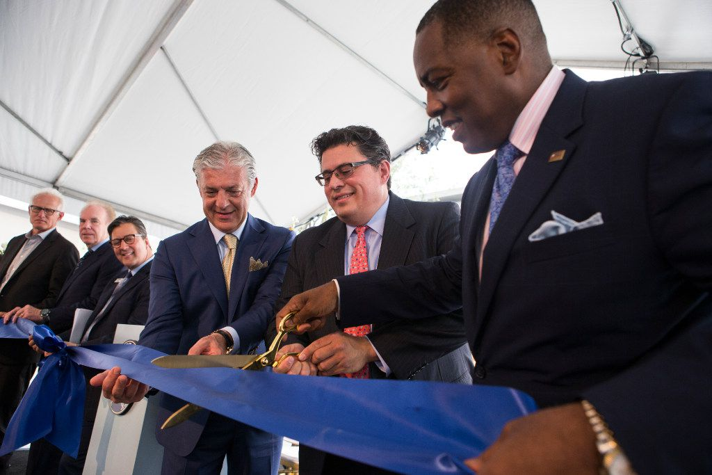 Plano Mayor Harry LaRosiliere, right, Secretary of State Rolando Pablos, and developer Fehmi Karahan cut the ribbon during the grand opening ceremony at Legacy West in Plano, Texas on Friday, Jun 2, 2017. (Ryan Michalesko/The Dallas Morning News)