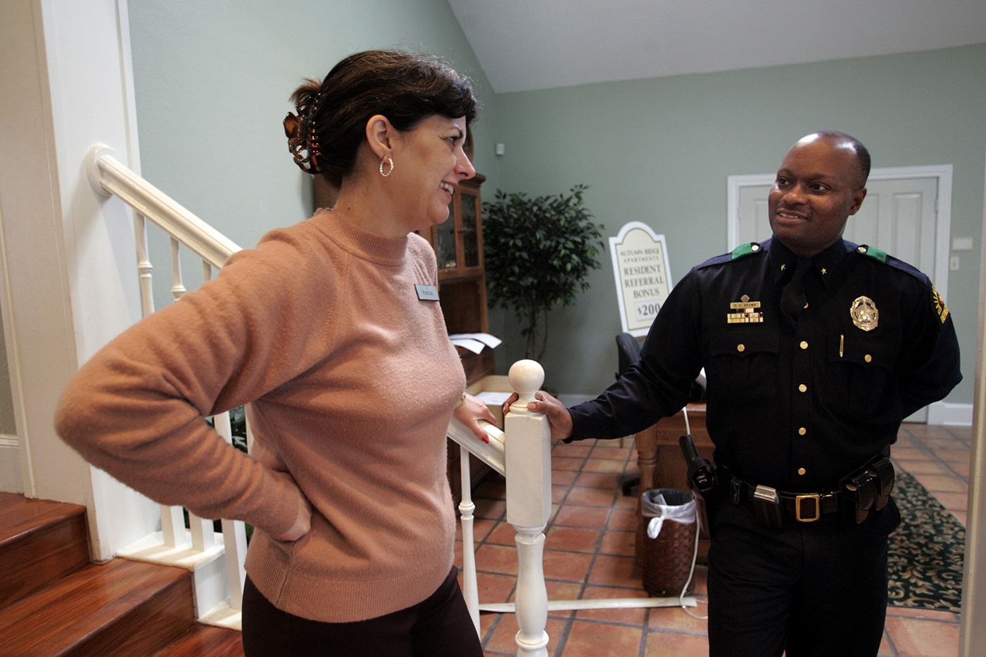 Autumn Ridge Apartment manager Patricia Bethencourt talks with DPD Deputy Chief David Brown about the decline in crime at her apartments.  Dallas Police Deputy Chief David Brown is leading a one-month initiative that stations dozens of officers in three of the the most crime-ridden apartment complexes.  The three apartment complexes located in far northeast Dallas are Autumn Ridge Apartments, Bent Creek Apartments , and Providence Apartment Homes. So far, the initiative has netted 47 felony arrest, 151 total arrests and 583 citations since December 13, 2004. Police hope that after they leave his month, residents at these apartments will be more likely to report crime and set-up crime watch meetings.