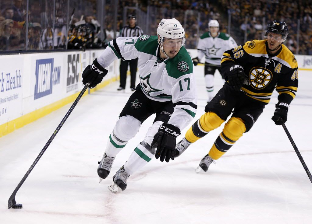 Dallas Stars' Devin Shore (17) handles the puck along the boards as Boston Bruins' David Krejci (46) defends during the first period of an NHL hockey game in Boston, Tuesday, Nov. 3, 2015. (AP Photo/Michael Dwyer)