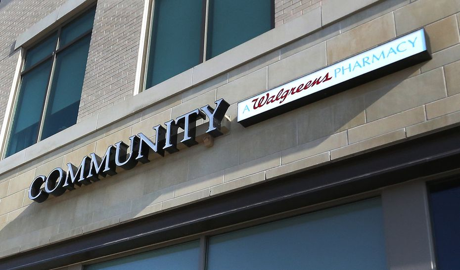 """The logo at the Walgreens Community Pharmacy at 7859 Walnut Hill Lane in Dallas, emphasizes """"community"""" with the company's traditional signature smaller and off to the side."""