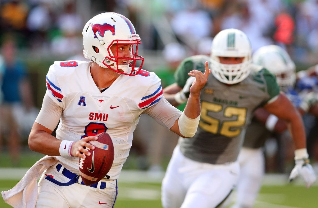 WACO, TX - SEPTEMBER 10:  Ben Hicks #8 of the Southern Methodist Mustangs looks for an open receiver against Greg Roberts #52 of the Baylor Bears in the seconf half at McLane Stadium on September 10, 2016 in Waco, Texas.  (Photo by Tom Pennington/Getty Images)