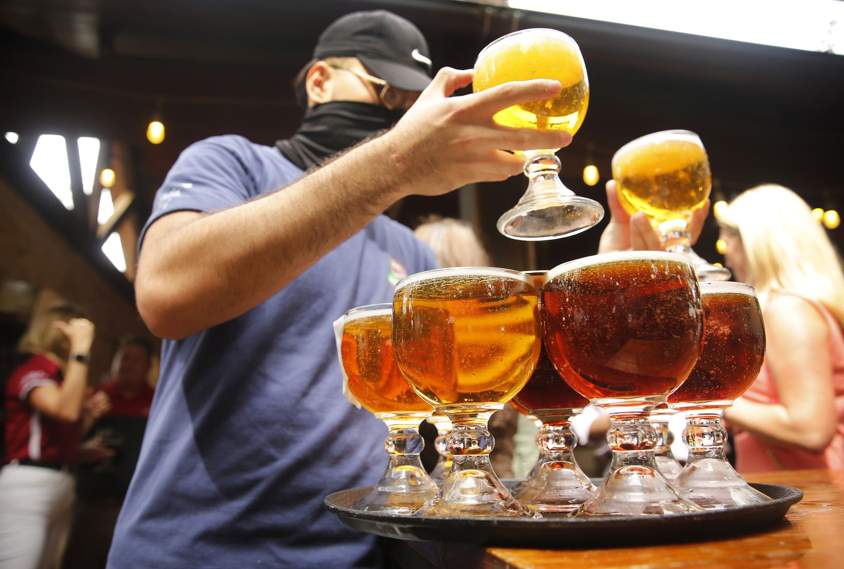A stack of schooners filled with Yuengling Lager and Yuengling Flight are served at a ceremonial event celebrating Yuengling's move into at Katy Trail Ice House in Dallas.