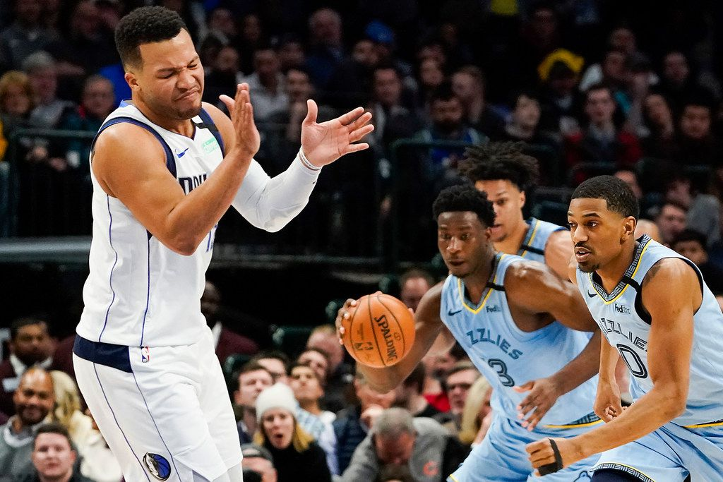 Dallas Mavericks guard Jalen Brunson reacts after turning the ball over to Memphis Grizzlies forward Jaren Jackson Jr. (13) during the first half of an NBA basketball game at American Airlines Center on Wednesday, Feb. 5, 2020, in Dallas.