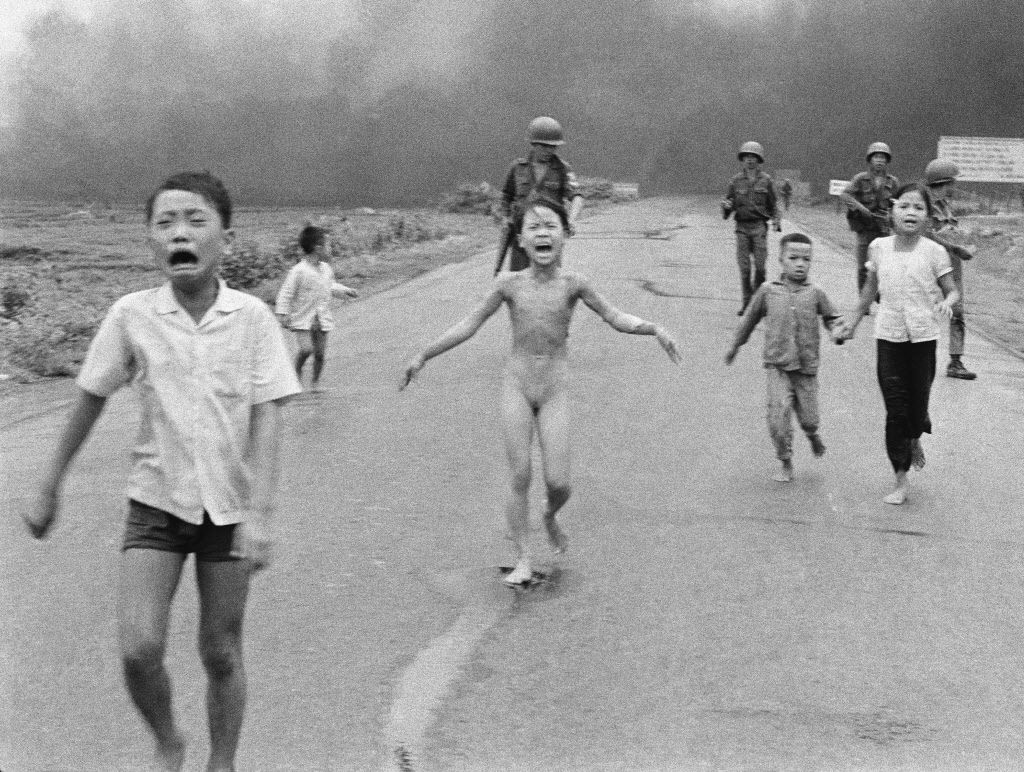 "In this June 8, 1972 file photo taken by Huynh Cong ""Nick' Ut, South Vietnamese forces follow terrified children, including 9-year-old Kim Phuc, center, as they run down Route 1 near Trang Bang after an aerial napalm attack on suspected Viet Cong hiding places. After making the photo, he set aside his camera, gave the badly burned girl water, poured more on her wounds, then loaded her and others into his AP van to take them to a hospital. When doctors refused to admit her, saying she was too badly burned to be saved, he angrily flashed his press pass. The next day, he told them, pictures of her would be displayed all over the world, along with an explanation of how the hospital refused to help."