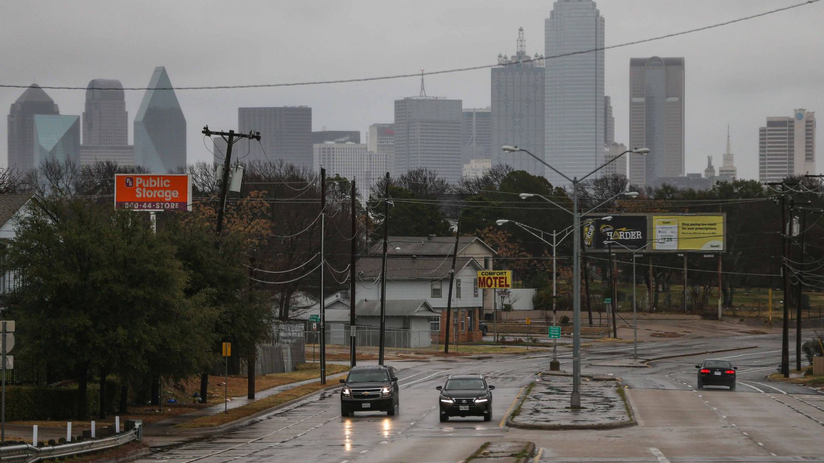 Motorists drove along rain-slicked Fort Worth Avenue and Vilbog Road in Dallas in December.