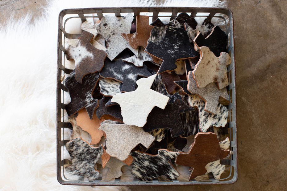 Coasters from Cowhide Couture of Rockwall sold at the Texas Goods Co. opening in late August in East Dallas  Hillside Village shopping center.