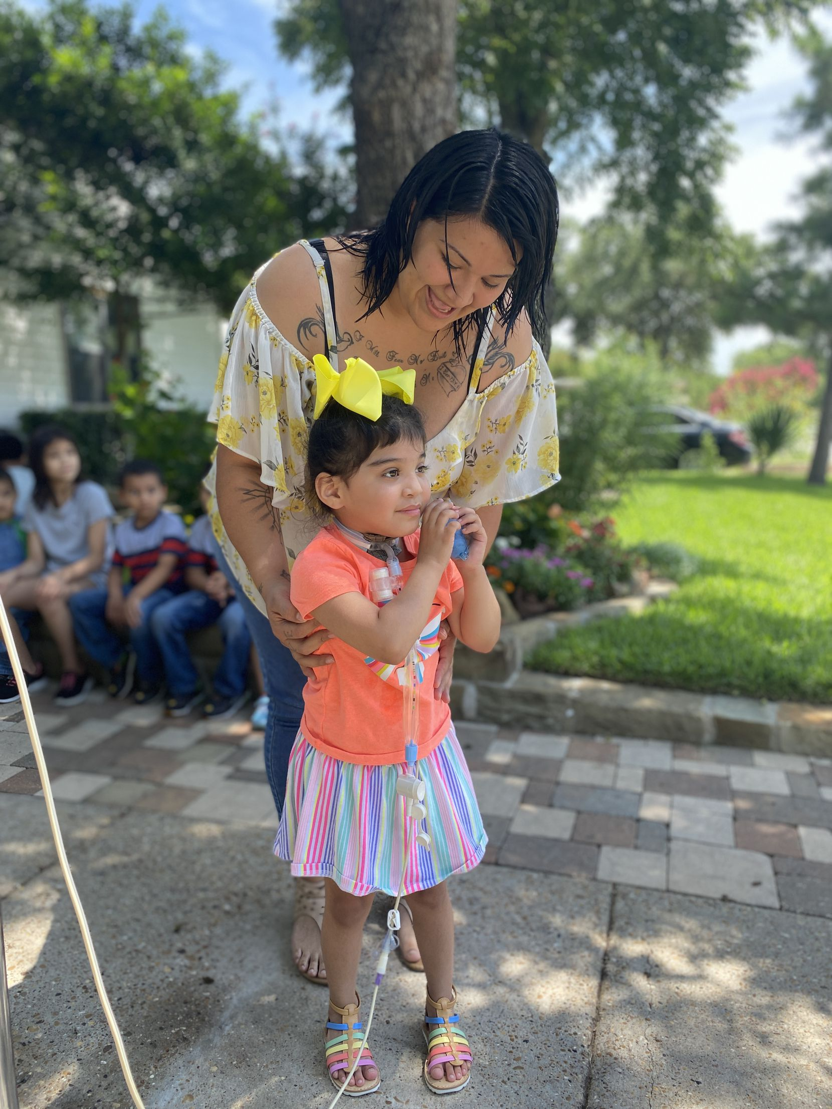 Sarai Tirado stands with her mother, Andrea, at her home in Irving on Tuesday, July 7, 2020. Sarai, 4, recently returned home from the hospital where she was recovering after unsecured furniture fell on her.