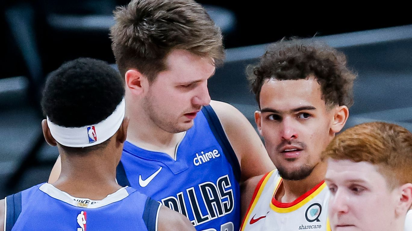Dallas Mavericks guard Luka Doncic, back left, and Atlanta Hawks guard Trae Young, back right, greet each other after an NBA basketball game in Dallas, Wednesday, February 10, 2021. Dallas won 118-117.