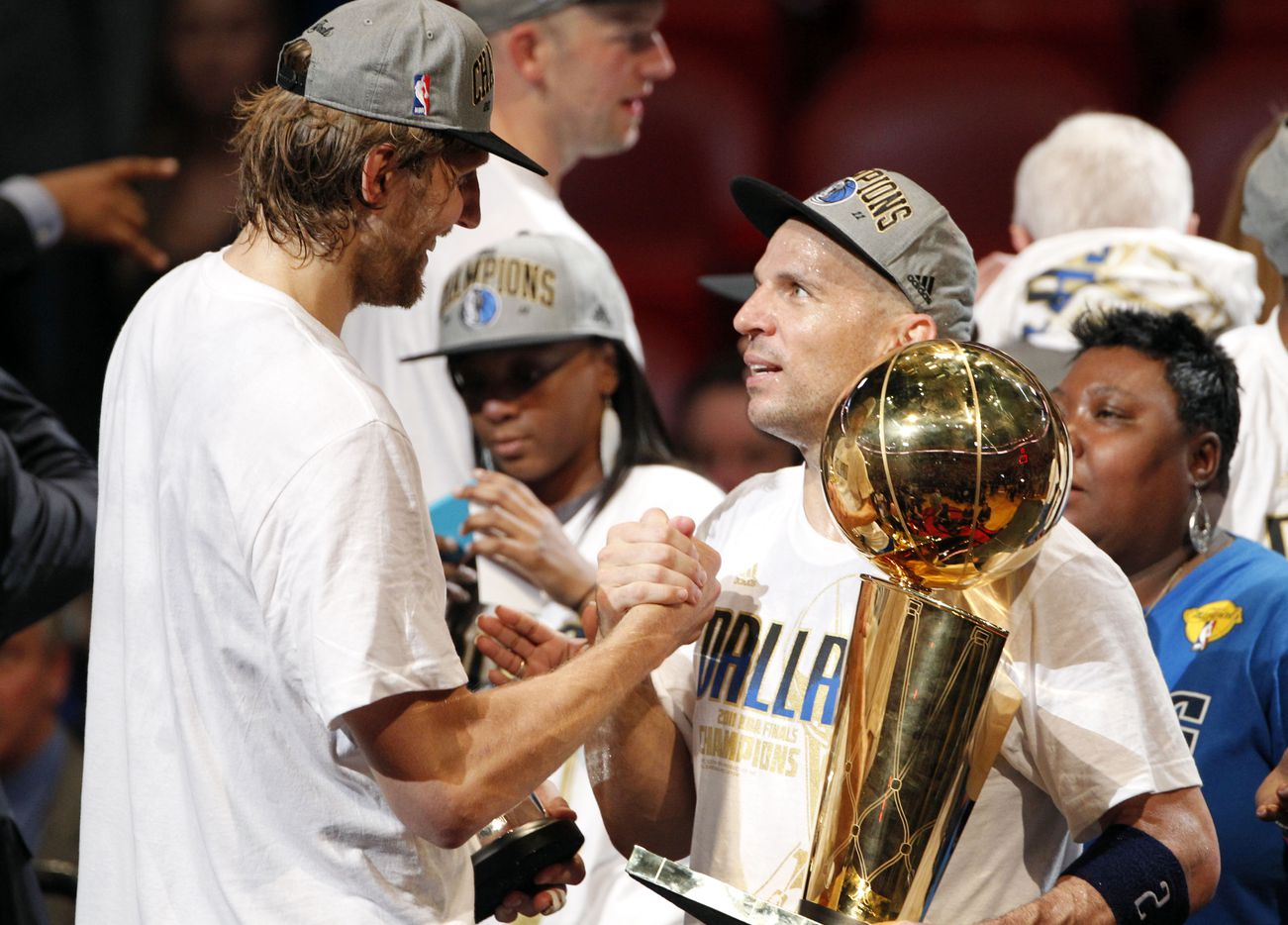 Dallas Mavericks power forward Dirk Nowitzki (41) and Dallas Mavericks point guard Jason Kidd (2) congratulate each other after game six of the NBA Finals between the Miami Heat and the Dallas Mavericks at the American Airlines Arena in Miami, Florida, June 12, 2011. The Mavericks won 105-95 to take the title. (Vernon Bryant/The Dallas Morning News) Kidd is holding the Larry O'Brien NBA Championship trophy