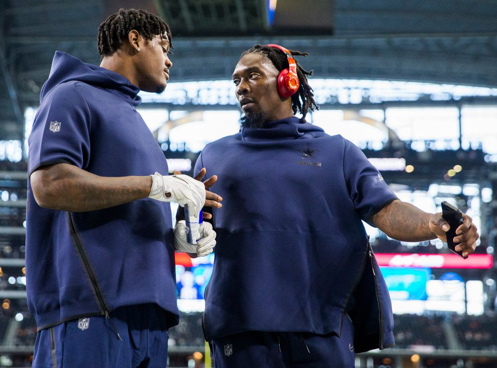 Dallas Cowboys defensive end Randy Gregory (94) drinks a Reb Bull and talks with defensive end Demarcus Lawrence (90) during warm ups before a Thanksgiving Day NFL football game between the Dallas Cowboys and the Washington Redskins on Thursday, November 22, 2018 at AT&T Stadium in Arlington, Texas. (Ashley Landis/The Dallas Morning News)