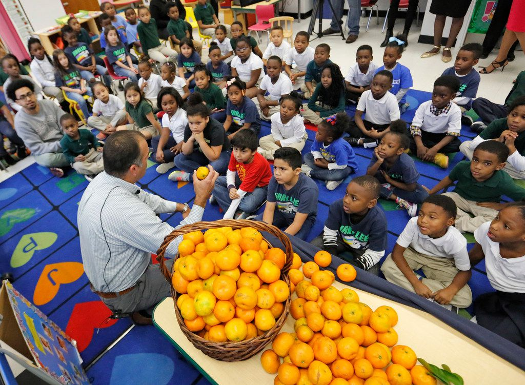 Farmer Christopher Sturdivant of Alvin, Texas, talked with students at N.W. Harllee Early Childhood Center in Dallas as they learn about locally sourced foods on Dec. 13, 2018. Dallas ISD is among 10 major urban districts in the country vowing to increase the amount of food that is locally sourced.