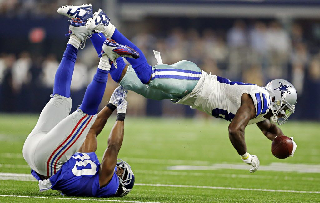 Dallas Cowboys wide receiver Dez Bryant (88) goes airborn as he's tackled by New York Giants cornerback Prince Amukamara during the second half of their game Sunday, September 13, 2015 at AT&T Stadium in Arlington, Texas. Bryant suffered a foot injury on the play and had to leave the game.  (G.J. McCarthy/The Dallas Morning News) 09162015xPUB 09152015xPUB