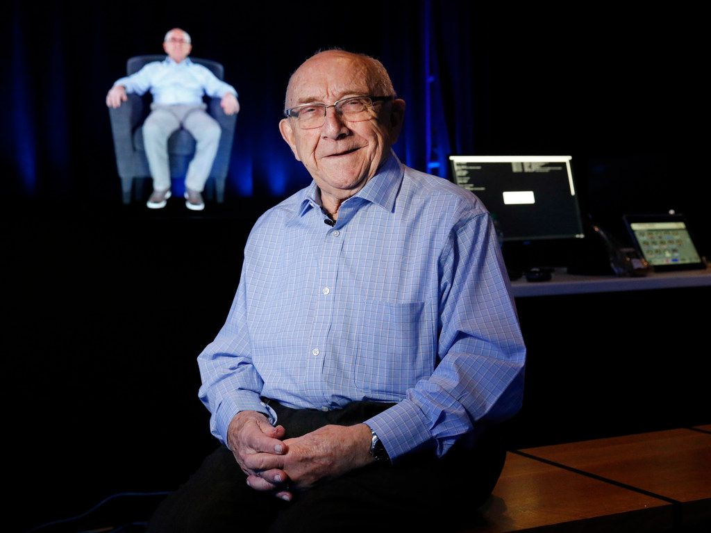 Holocaust survivor Max Glauben poses for a photo before a holographic image of himself in the Dimensions in Testimony interactive exhibit at the new Dallas Holocaust and Human Rights Museum in downtown Dallas. Visitors can sit across from a Holocaust survivor and ask questions.