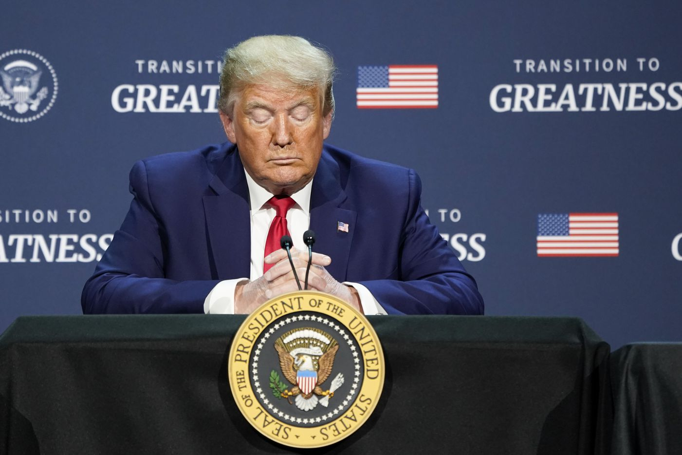 President Donald Trump bows his head in prayer during a roundtable conversation about race relations and policing at Gateway Church Dallas Campus on Thursday, June 11, 2020, in Dallas. (Smiley N. Pool/The Dallas Morning News)