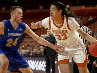 Texas forward Kamaka Hepa (33) drives against South Dakota State forward Mike Daum (24) during a first round game of the NCAA college basketball National Invitation Tournament in Austin, Texas, Tuesday, March 19, 2019. (Nick Wagner/Austin American-Statesman via AP)