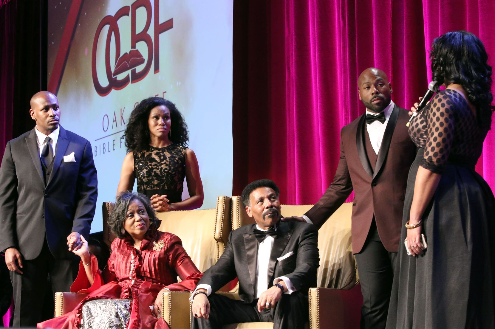 Surrounded by children Jonathan Evans (left),  Priscilla Shirer (back center) and Anthony Evans, Lois and Tony Evans listen to their daughter, Chrystal Evans Hurst, talk during OCBF's 40th Anniversary Gala in 2016.