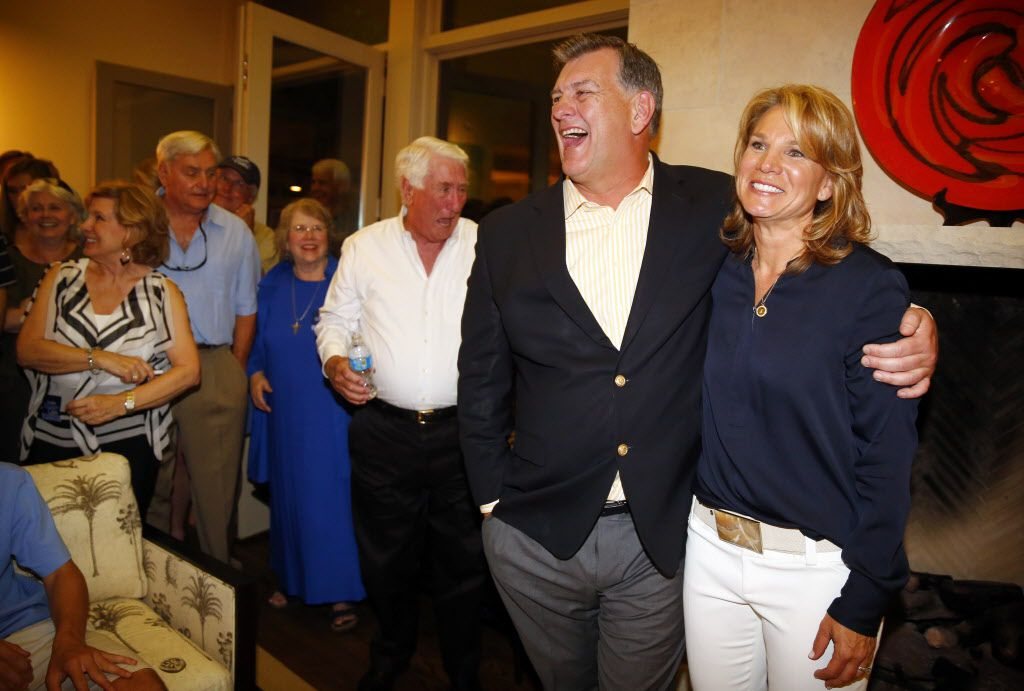 Dallas City Council member Jennifer Staubach Gates receives a hug from former Dallas mayor Mike Rawlings following her acceptance speech among friends and supporters at her home, Saturday evening, May 11, 2013. In an interview this last week, Gates remembered that her father, Roger Staubach, learned of her first political candidacy from Rawlings. (Tom Fox/The Dallas Morning News) 05122013xNEWS