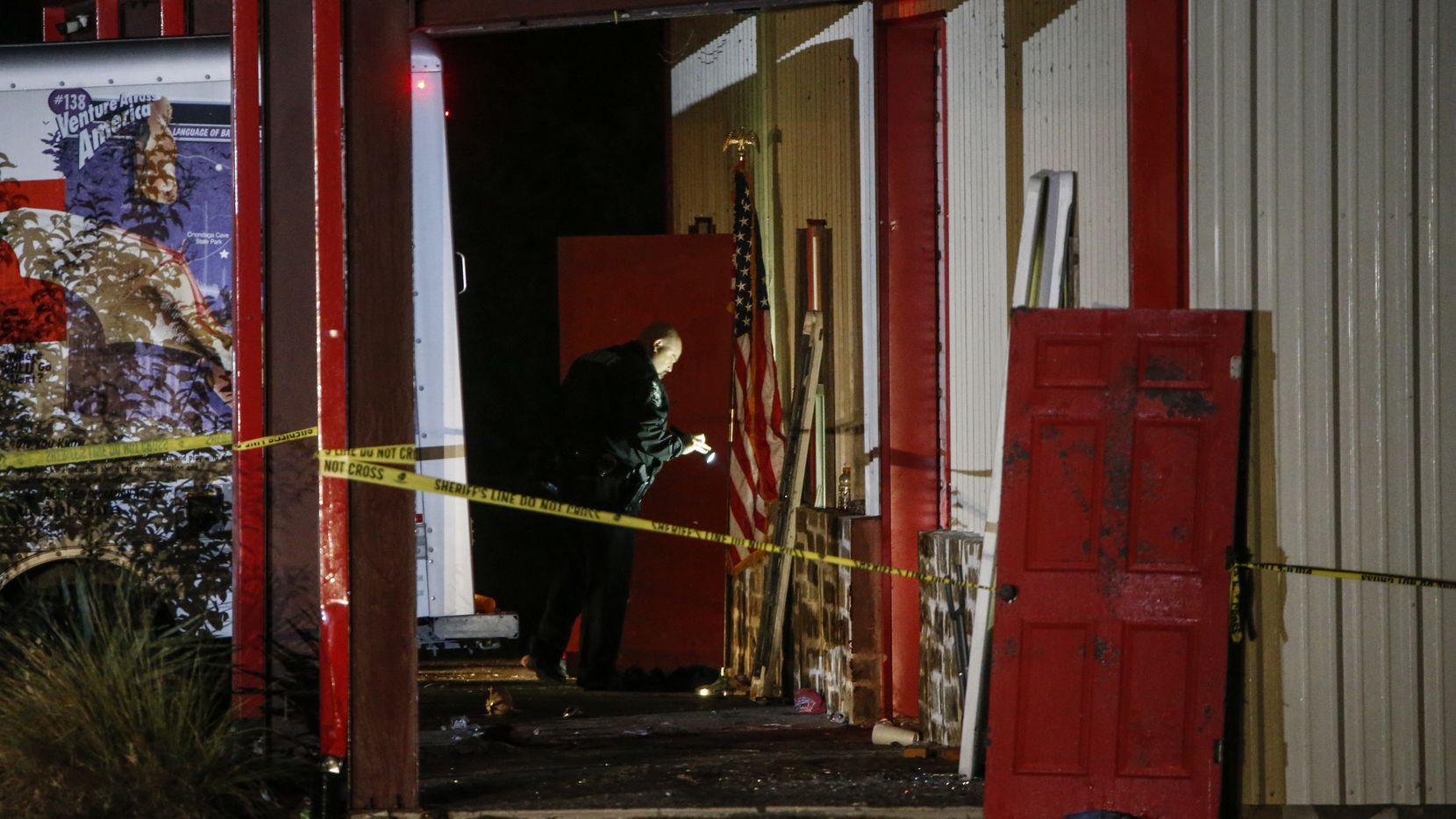 Officials work a crime scene after a shooting at Party Venue on Highway 380 in Greenville, Texas, on Sunday, October 27, 2019. As of early Sunday morning a gunman is still at large after killing at least two people and injuring 14 at Party Venue Saturday night, according to Hunt County Sheriff Randy Meeks.