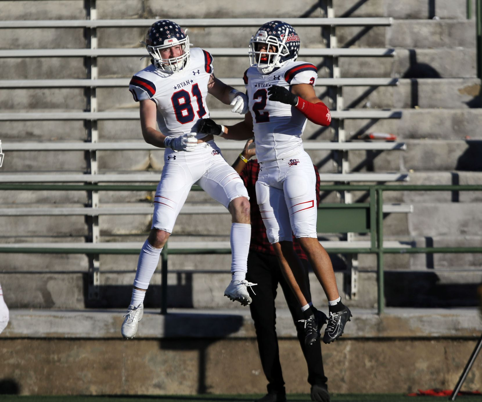 Denton Ryan's Keagan Cunningham (81) and Billy Bowman Jr. (2) celebrate after Cunningham's touchdown catch during the first half of a Class 5A Division I Region I semifinal football playoff game against Longview High at Mesquite Memorial  Stadium in Mesquite on Saturday, December 26, 2020. (John F. Rhodes / Special Contributor)