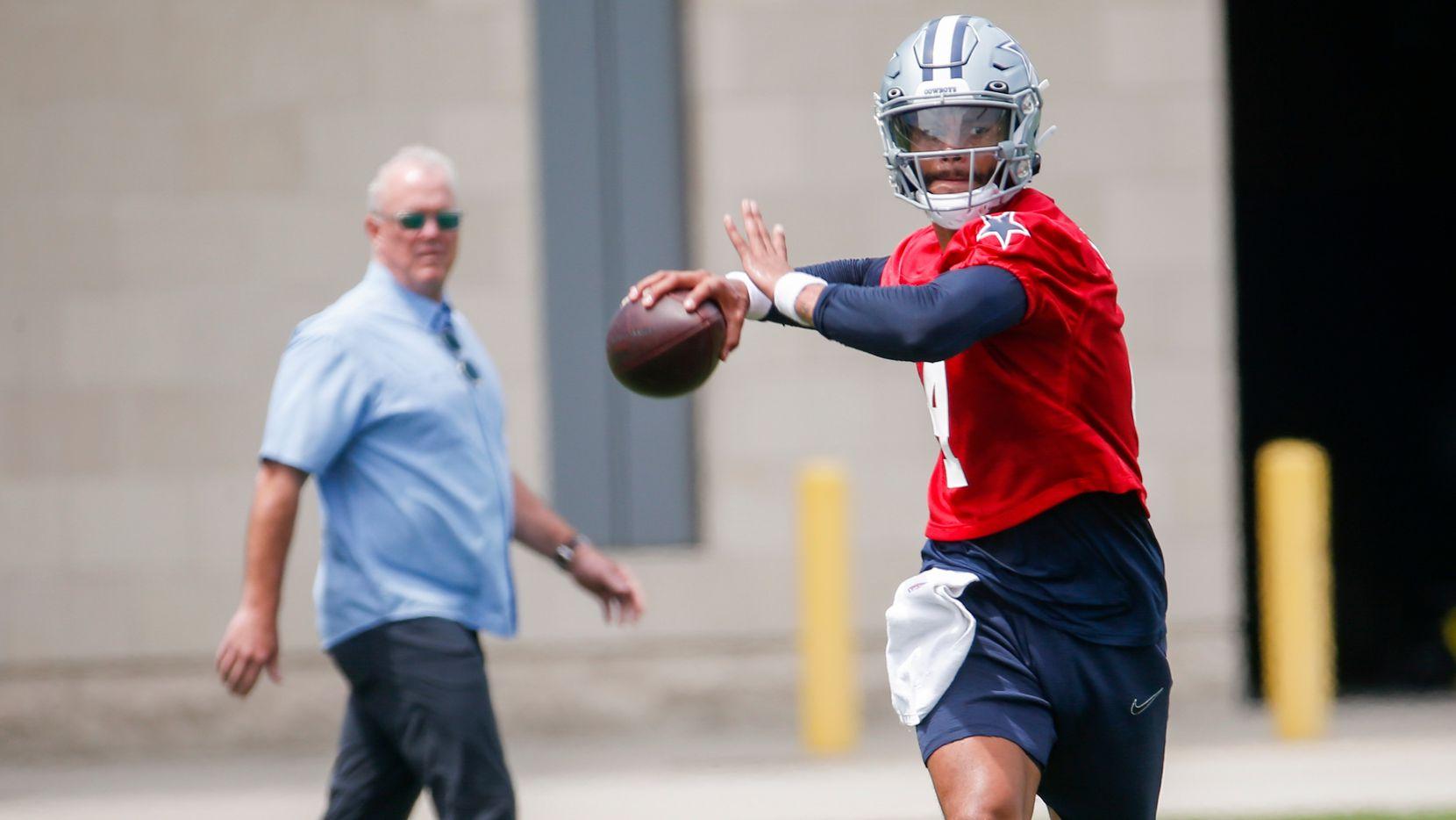 Dallas Cowboys CEO Stephen Jones watches as Dallas Cowboys quarterback Dak Prescott (4) practices during the Cowboys second OTA practice on Thursday, June 3, 2021, at the Star in Frisco. (Juan Figueroa/The Dallas Morning News)