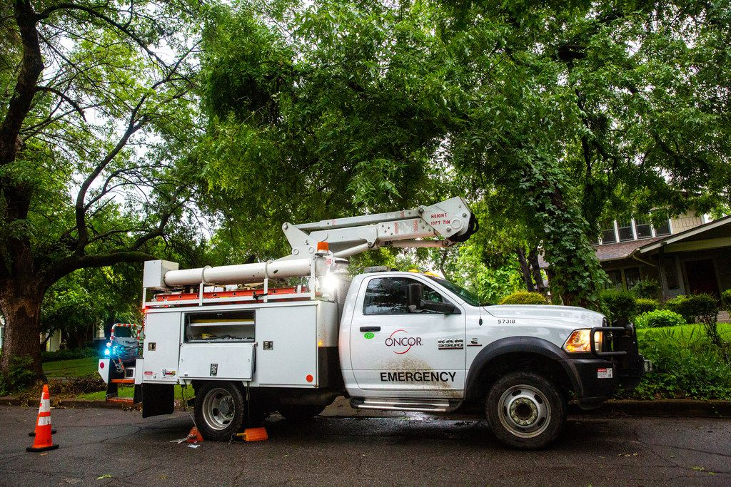 A utility vehicle for Oncor Electric Delivery is seen in the Junius Heights neighborhood in Dallas after a severe thunderstorm caused power outages throughout the city on Sunday, June 16, 2016. (Lynda M. Gonzalez/The Dallas Morning News)