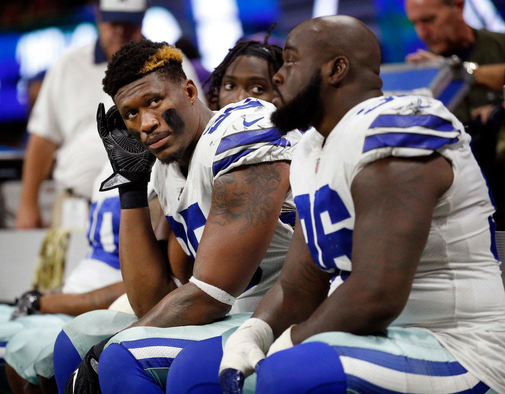 Dallas Cowboys defensive tackle David Irving (95) and the rest of the line watch as the Atlanta Falcons cruise to win in the fourth quarter at Mercedes-Benz Stadium in Atlanta, Georgia, Sunday, November 12, 2017.