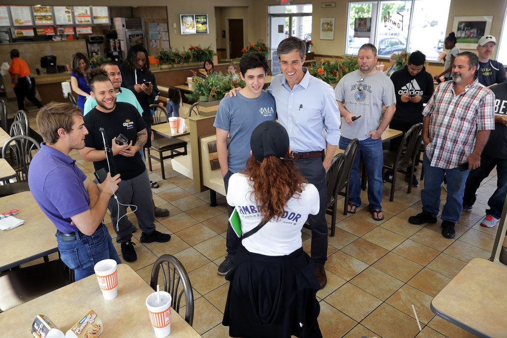 O'Rourke poses for photographs with supporters while taking a break from canvassing to eat lunch with his family and campaign staff at a Whataburger November 3, 2018, in Dallas.