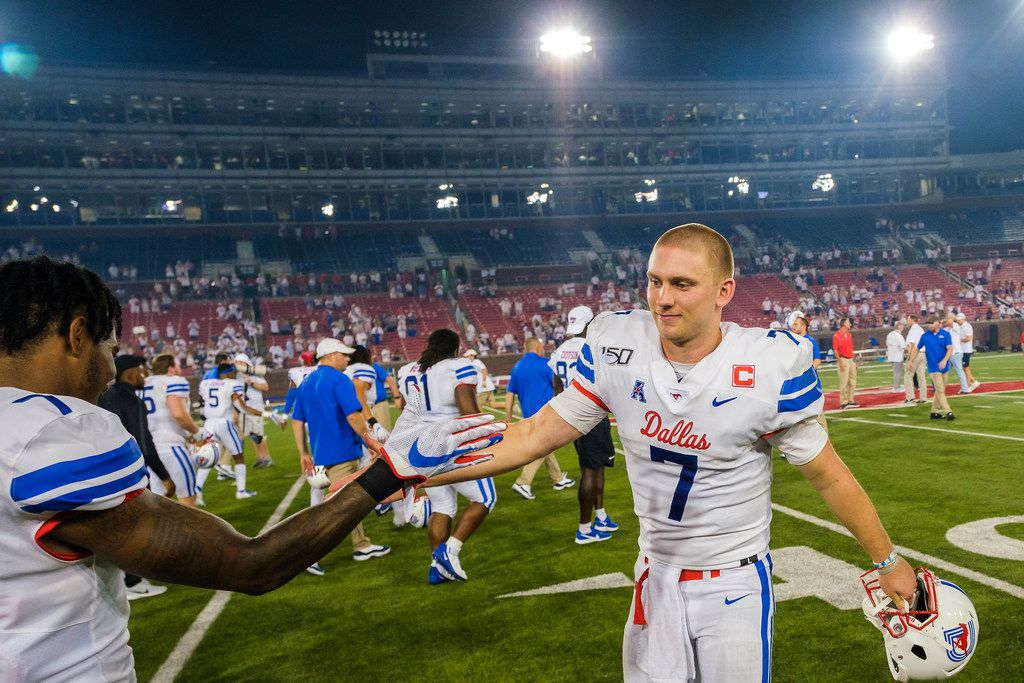 SMU quarterback Shane Buechele (7) celebrates with cornerback Robert Hayes Jr. after the Mustangs 49-27 victory over UNT in an NCAA football game at Ford Stadium on Saturday, Sept. 7, 2019, in Dallas. (Smiley N. Pool/The Dallas Morning News)
