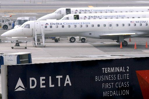 Delta Connection regional jets are parked on the tarmac at John F. Kennedy Airport in New York. (File Photo/Bloomberg)