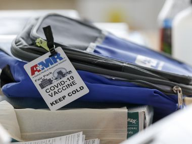 A bag containing COVID-19 vaccines rests on a table during the last day of vaccinations at the drive-thru Fair Park site on Saturday, July 17, 2021, in Dallas.
