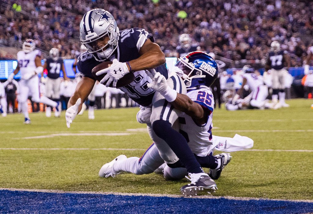 FILE - Cowboys wide receiver Randall Cobb (18) crosses the goal line while being tackled by New York Giants defensive back Corey Ballentine (25) during the first quarter of a game on Monday, Nov. 4, 2019, at MetLife Stadium in East Rutherford, N.J. The touchdown was overturned after a penalty.
