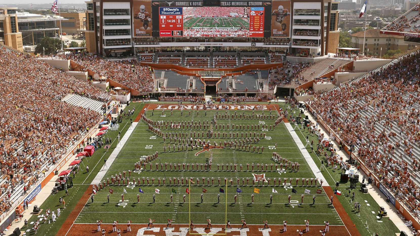 The south end zone expansion at DKR-Texas Memorial Stadium is complete with an upgraded video scoreboard, new suites, clubs, loge boxes, sponsor amenities and new fan seating around an orange cutout of a longhorn.  The expansion completes the stadium bowl pushing seating capacity over 100,000.  The completed structure and new turf field is pictured during the season opener against the Louisiana-Lafayette Ragin Cajuns in Austin, Saturday, September 4, 2021. (Tom Fox/The Dallas Morning News)