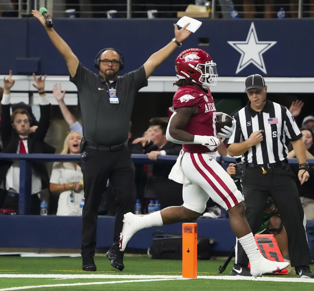 Arkansas running back AJ Green (0) scores on a 48-yard touchdown during the first half of an NCAA football game against Texas A&M at AT&T Stadium on Saturday, Sept. 25, 2021, in Arlington.