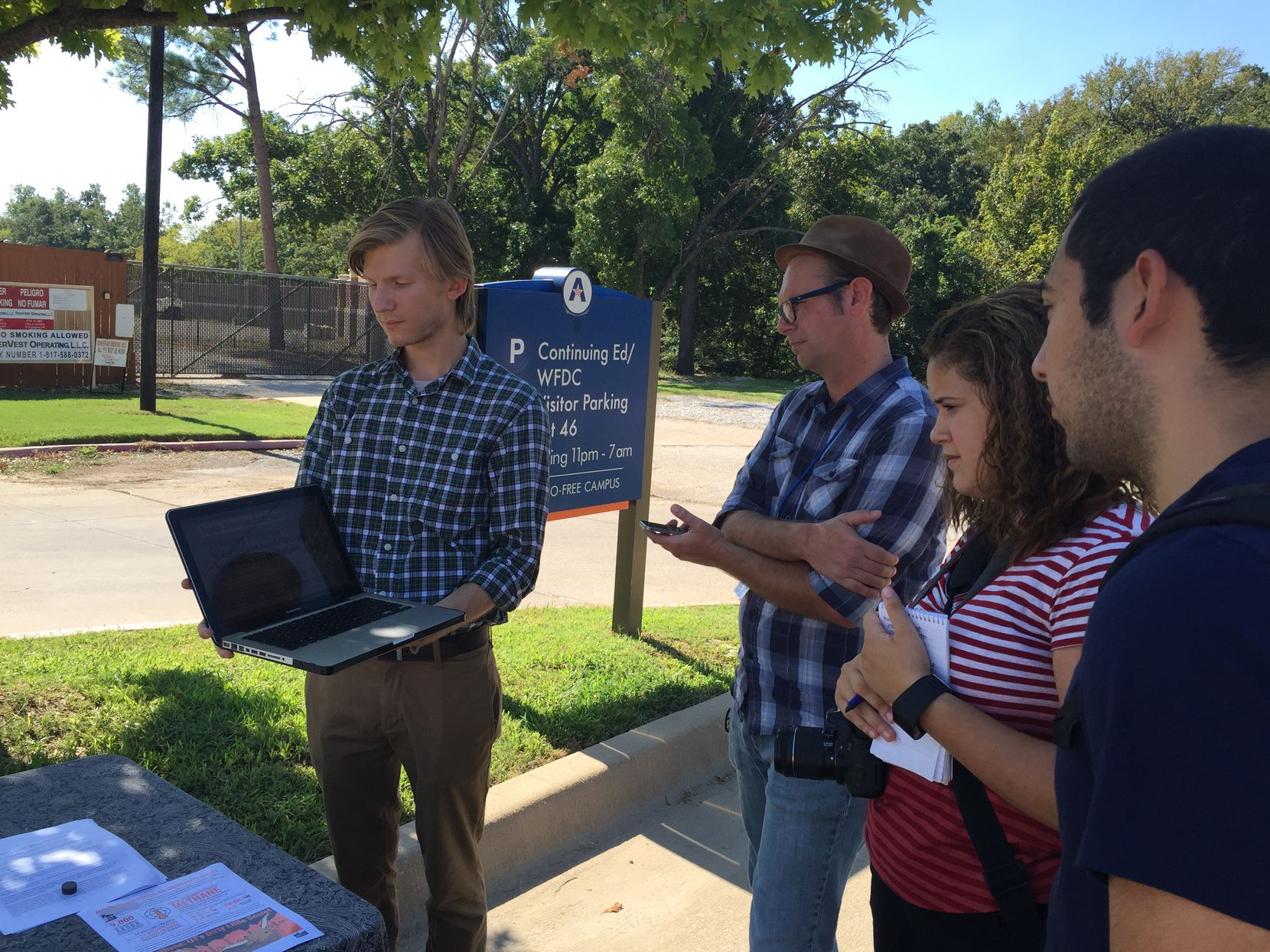 Cyrus Rautman (left) of Environment Texas and others participated in a news conference Wednesday on the University of Texas at Arlington campus. The group is urging the University of Texas system to clamp down on methane emissions at gas drilling and production sites on UT land.