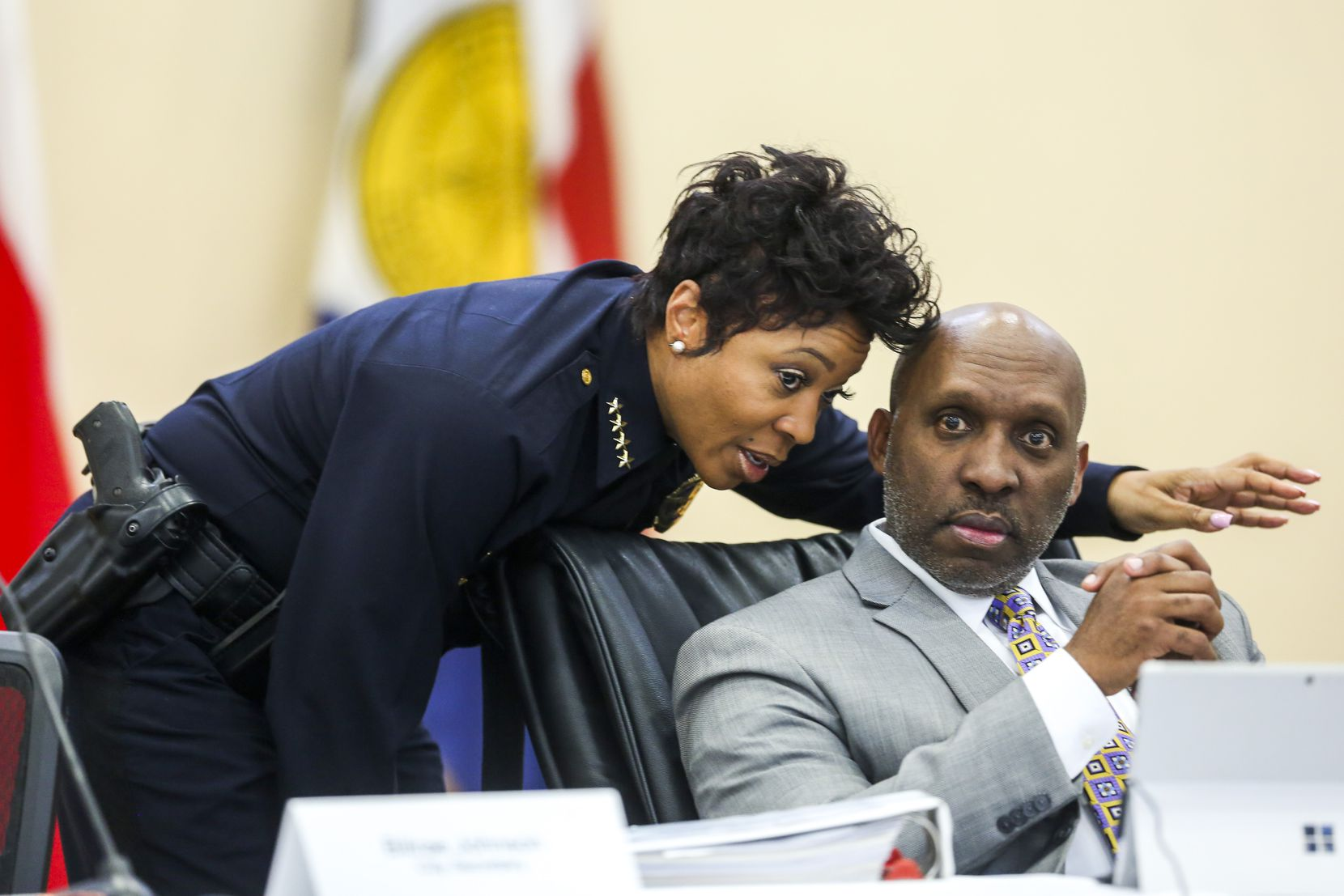 Dallas Police Chief U. Reneé  Hall talks to her boss, Dallas City Manager T.C. Broadnax, during a City Council meeting in February 2019.  Hall resigned in September and will leave the department at the end of the year.