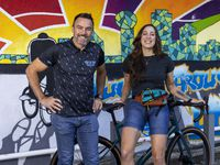 Dallas Bike Works owner Boyd Wallace stands with Pull Through Coffee owner Christina James. The coffee bar is being built inside Dallas Bike Works. James painted the mural along the back wall.