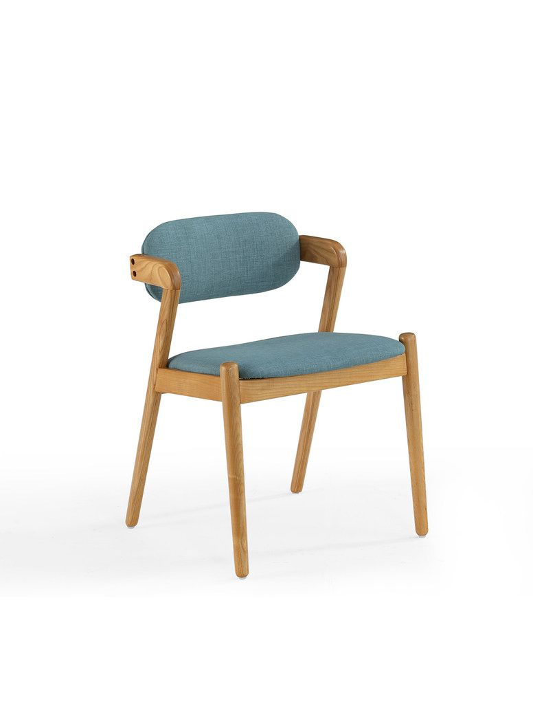 Jonathan Adler's Now House collection features a mid-century dining chair in light wood with blue linen upholstery. It's $198.
