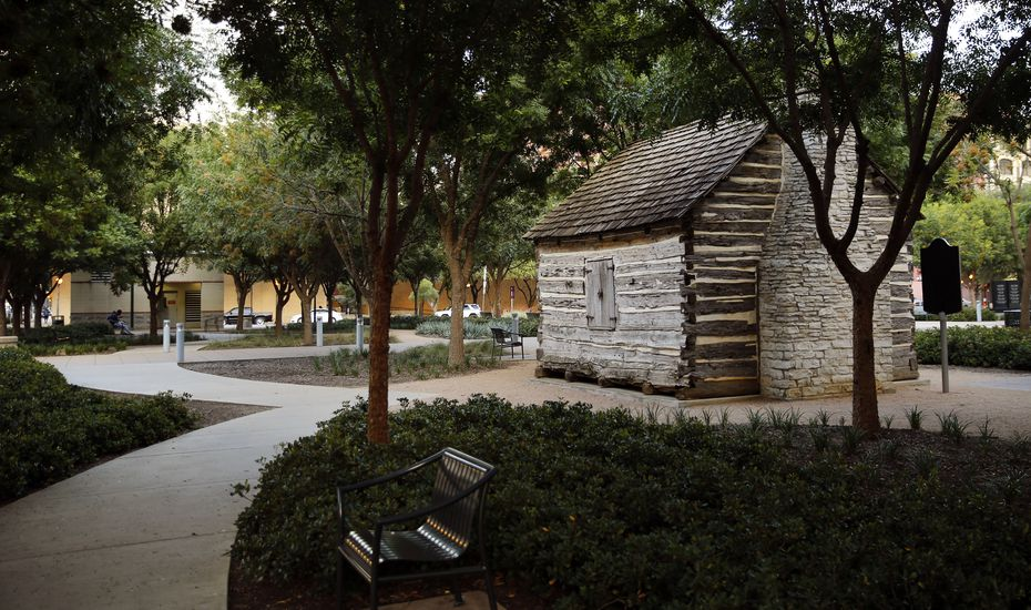 A replica of John Neely Bryan's cabin sits in Founders Plaza on Elm Street. in downtown Dallas.