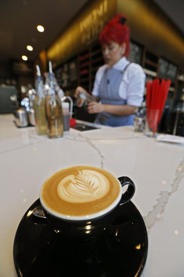 Briana Flores, barista, makes coffee at Ascension Coffee Roasters at The Crescent  in Dallas, TX June 28, 2016.  (Nathan Hunsinger/The Dallas Morning News)