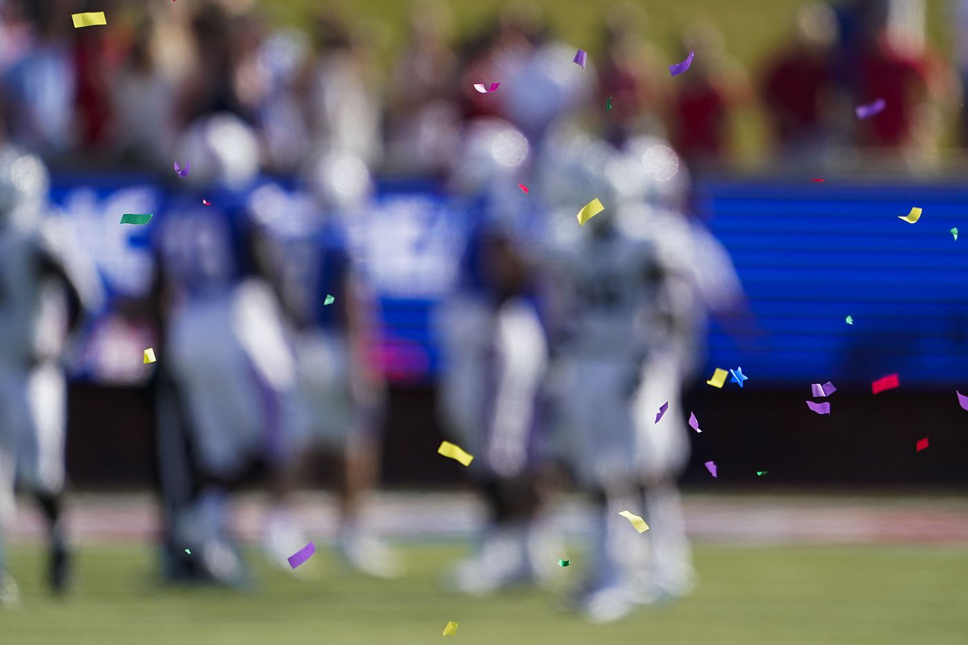 Confetti from the celebration of an interception by SMU cornerback Brandon Crossley floats over the field during the first half of an NCAA football game against Memphis at Ford Stadium on Saturday, Oct. 3, 2020, in Dallas.