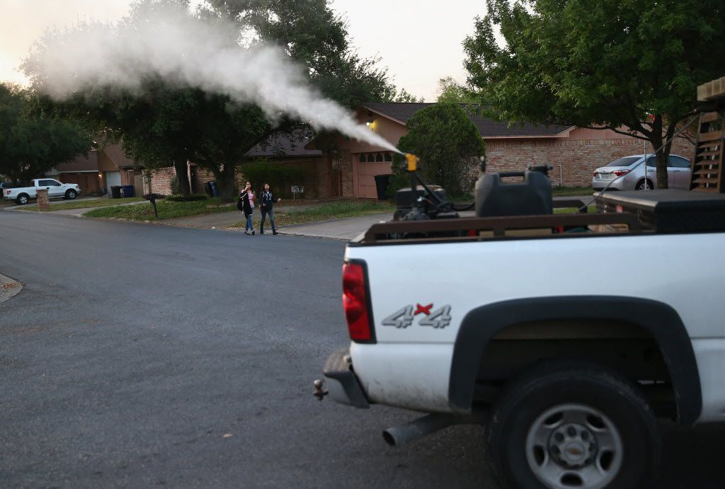 Currently, counties around Texas, including Dallas County, use ground spraying of insecticides to control mosquito populations and protect against mosquito-borne diseases like Zika and West Nile virus. Here, a neighborhood in McAllen is sprayed for mosquitoes early on April 14, 2016.