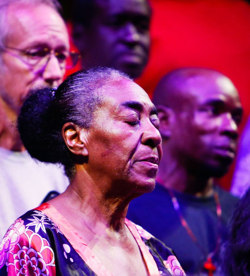 Margaret Lewis sings during the Dallas Street Choir performance at the Munger Place Church in Dallas.