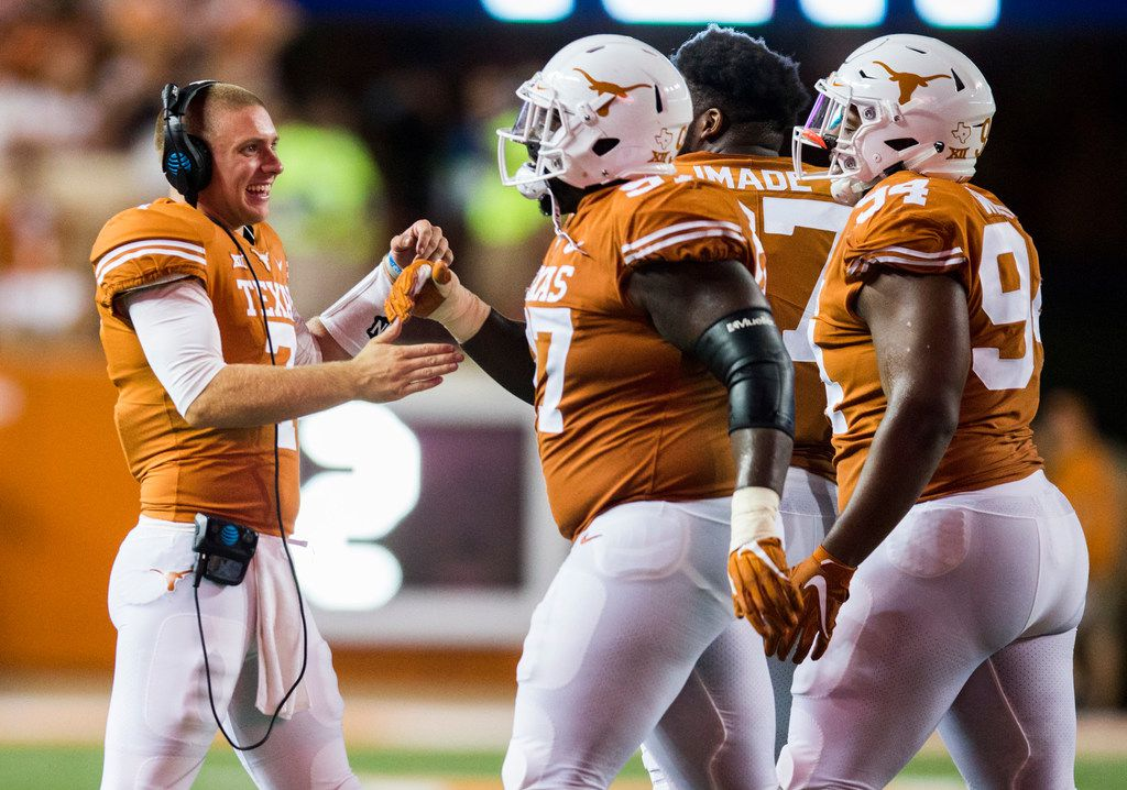 Ex-Texas Longhorns quarterback Shane Buechele (7) celebrates with teammates after a touchdown on Saturday, September 15, 2018 at Darrell K Royal Memorial Stadium in Austin, Texas.