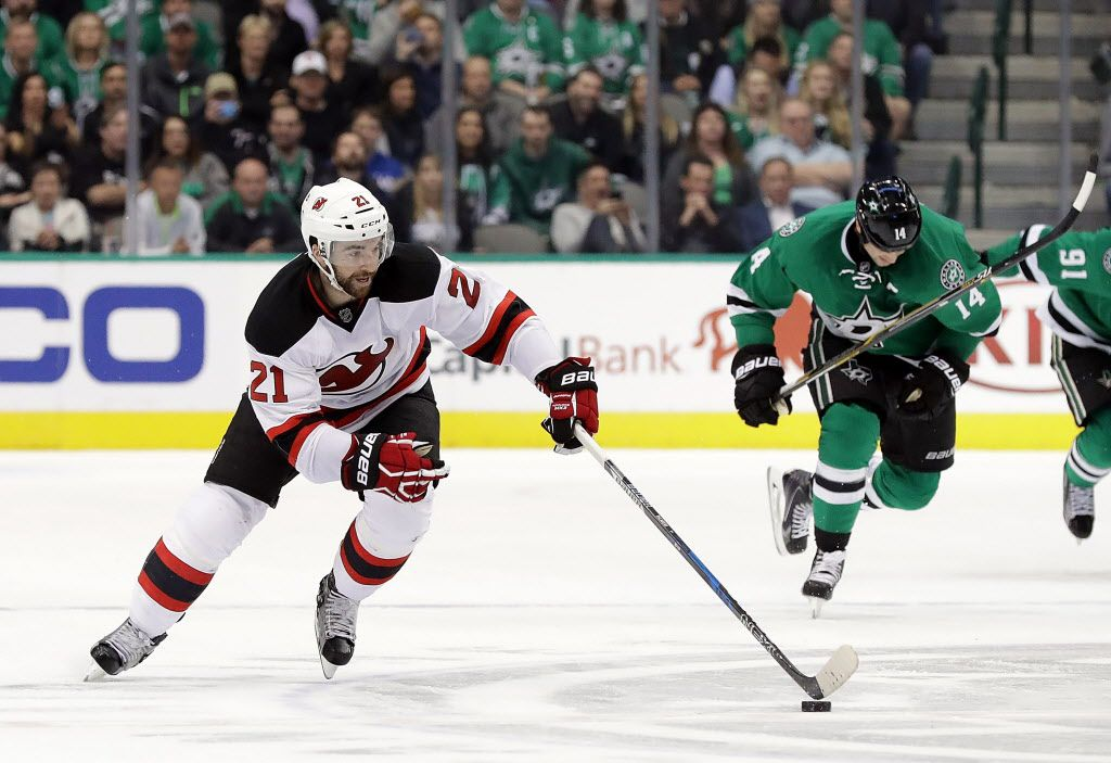 DALLAS, TX - NOVEMBER 15:  Kyle Palmieri #21 of the New Jersey Devils skates the puck against the Dallas Stars during overtime at American Airlines Center on November 15, 2016 in Dallas, Texas.  (Photo by Ronald Martinez/Getty Images)