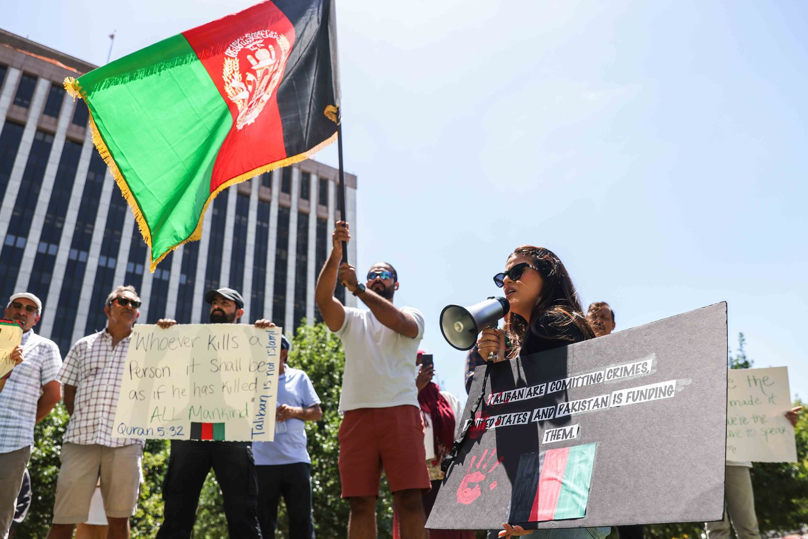 Sahar Salehi Abushagur, founder of the group Stop Killing Afghans group, addressed the crowd at Saturday's rally and march, which were held in and around Belo Garden in downtown Dallas.