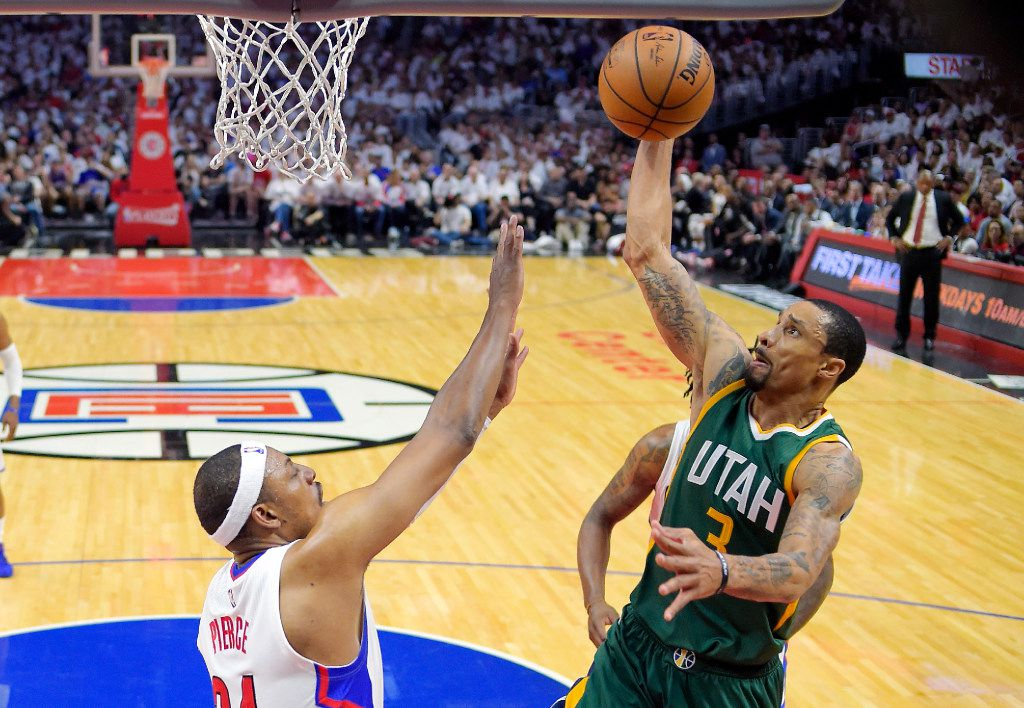 Utah Jazz guard George Hill, right, shoots as Los Angeles Clippers forward Paul Pierce defends during the second half in Game 7 of an NBA basketball first-round playoff series, Sunday, April 30, 2017, in Los Angeles. (AP Photo/Mark J. Terrill)